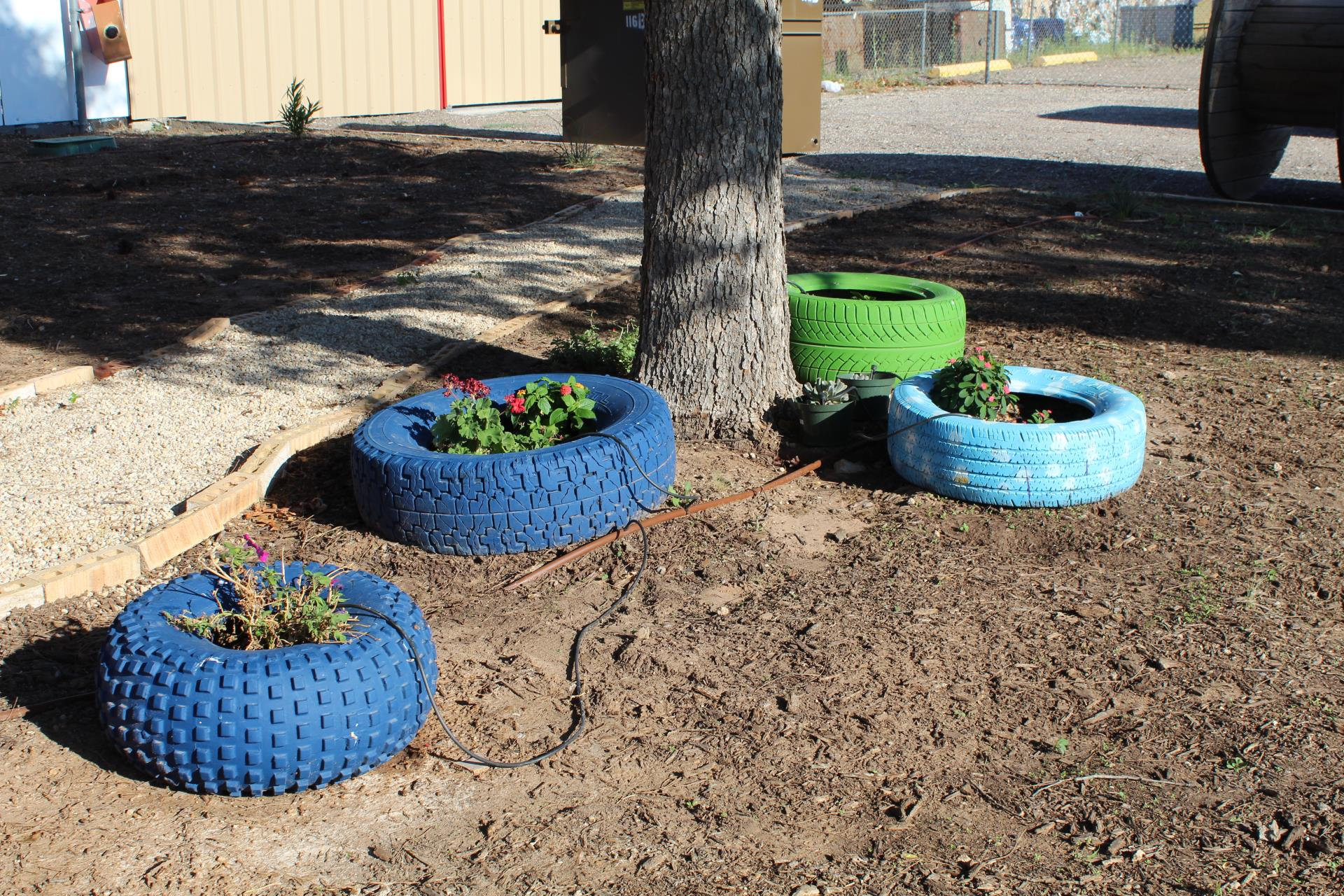 Four Blue and Green Painted Tire Planters