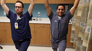 Dr. Sudip Bose and a colleague doing stretches