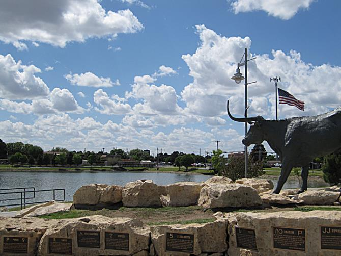 Bull Statue Overlooking Lake